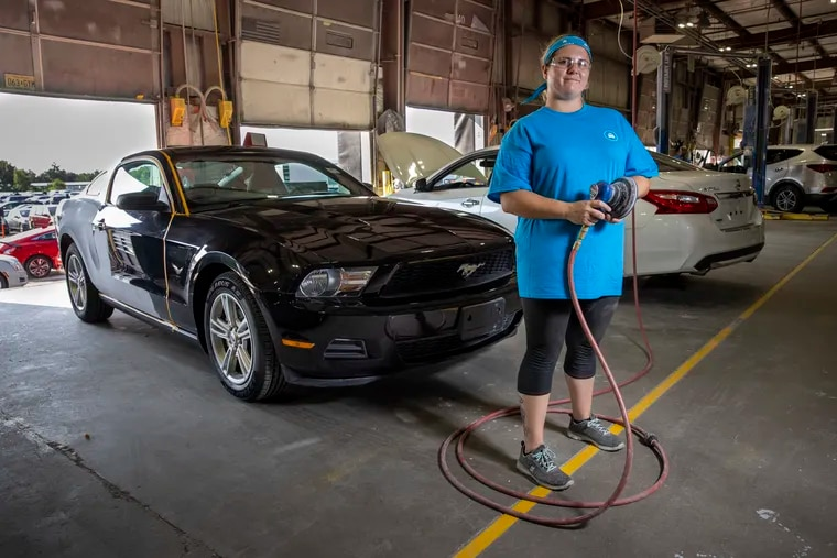 Shannon Driscoll works in the body shop at Carvana, the online car sales company, in Delanco.