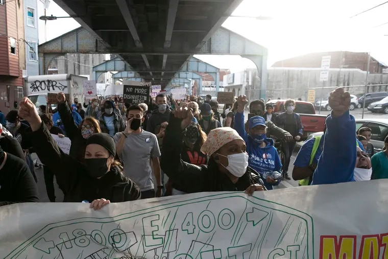 Community members and supporters march underneath the El down Kensington Avenue in protest after the Somerset Station was closed in March for repairs and cleaning. SEPTA said the station had broken elevators and was overwhelmed by drug use and homelessness.