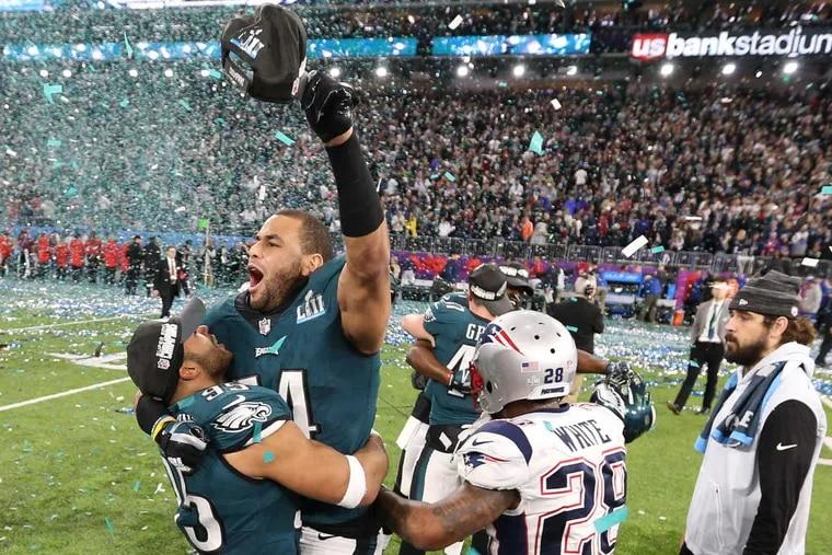 Eagles linebacker Mychal Kendricks and Eagles linebacker Kamu Grugier-Hill celebrate after Super Bowl LII, at U.S. Bank Stadium in Minneapolis.