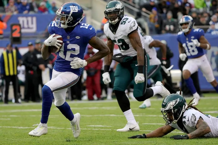 Ronald Darby, bottom right, can't catch the Giants' Tavarres King, left, during his third-quarter touchdown.