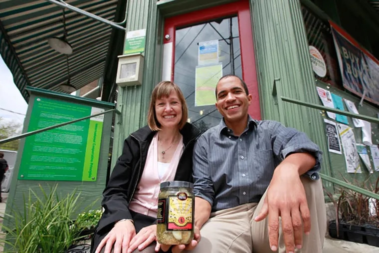 Victor Mallet and Elizabeth Killough with Weavers Way PhillyFresh Pickles outside the Mount Airy co-op. (David Swanson / Staff Photographer)
