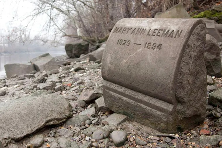 In the 1950s, tombstones from an old cemetery were discarded along the Delaware River.
