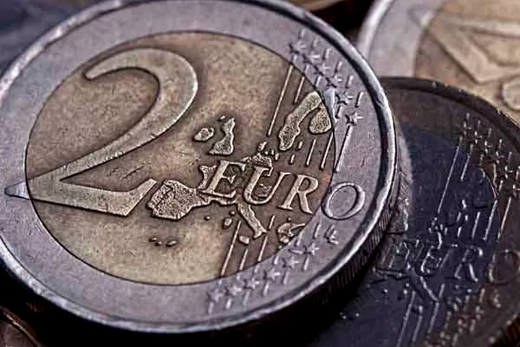 Two euro coins sit amongst euro coins of mixed denominations in this arranged photograph in London, U.K., on Thursday, April 12, 2012. The euro may fall to the weakest level in 22 months against the pound, after failing to rise above a key level of so-called resistance, Credit Suisse Group AG said, citing trading patterns. Photographer: Simon Dawson/Bloomberg