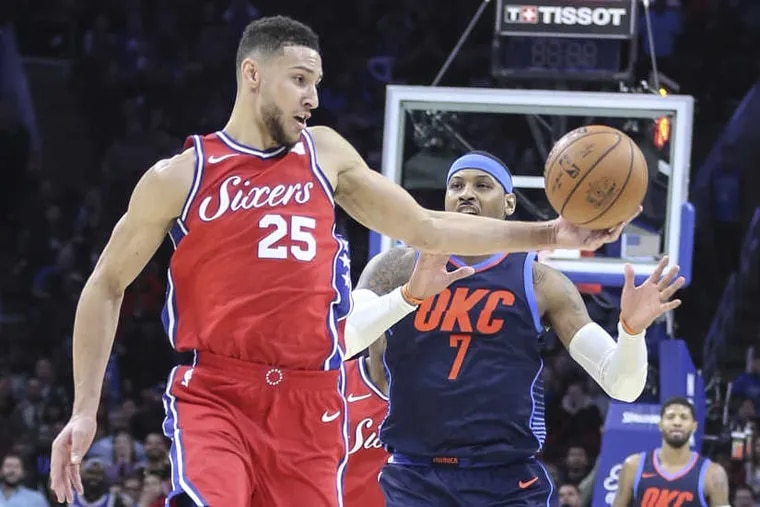 Sixers' Ben Simmons takes the ball from Thunder's Carmelo Anthony during overtime at the Wells Fargo Center in Philadelphia, Friday, Dec. 15, 2017. The Thunder beat the Sixers in triple overtime, 119-117.