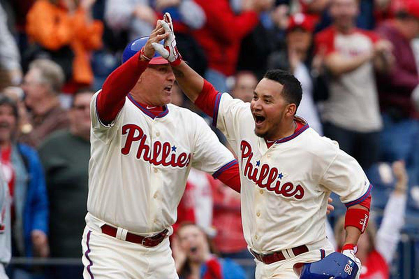 Phils stun Reds with wild ninth inning