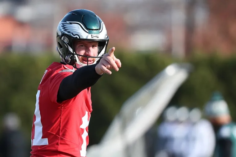 Eagles quarterback Carson Wentz points to a receiver during to the Philadelphia Eagles practice at the NovaCare Complex on Thursday. A big game by Wentz Sunday would go a long way in helping the Eagles beat the 8-1 Patriots.