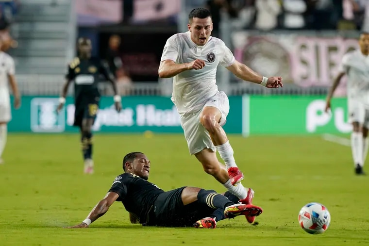 Union midfielder José Andrés Martínez, left, tackles the ball away from Inter Miami midfielder Lewis Morgan during the first half.