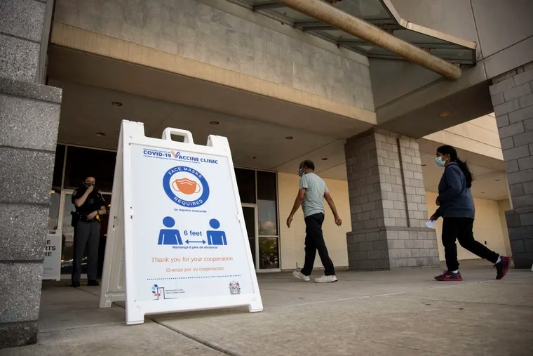 People arrive at the Montgomery County coronavirus vaccination site at the former JC Penney at the King of Prussia Mall in May.