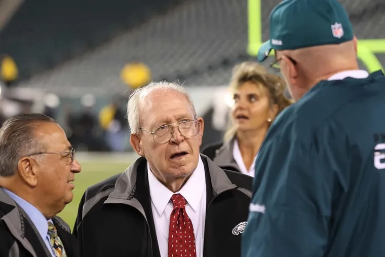 Jim Solano (left) alongside former Eagles coach Buddy Ryan (center) in 2011 when Ryan was honored by team. Solano was Ryan's agent.