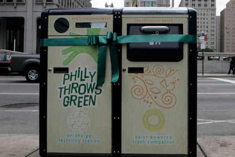 BigBellys like this one at 15th Street and JFK Boulevard will replace wire trash bins in Philadelphia. (Bonnie Weller / Staff Photographer)