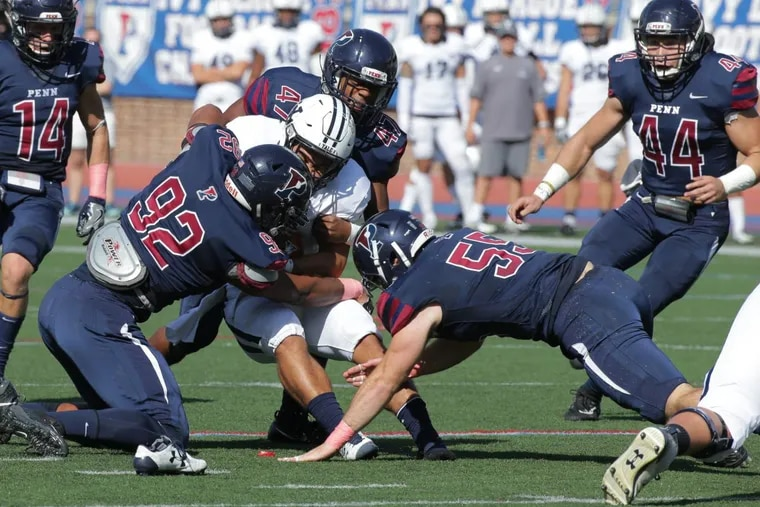 Penn linebacker Pat McInerney (55), playing against Yale, and his father, John, are both Ivy League champions.