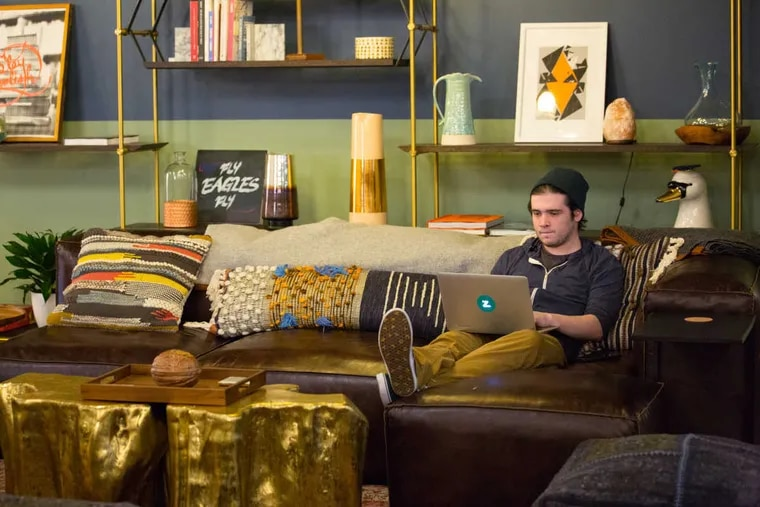 Mike Paszkiewicz, Cofounder of Habitat Food Fast, works in the coworking space WeWork on Market Street. WeWork has a new strategy to lure suburban companies and employees into town by subsidizing the onerous City Wage Tax.