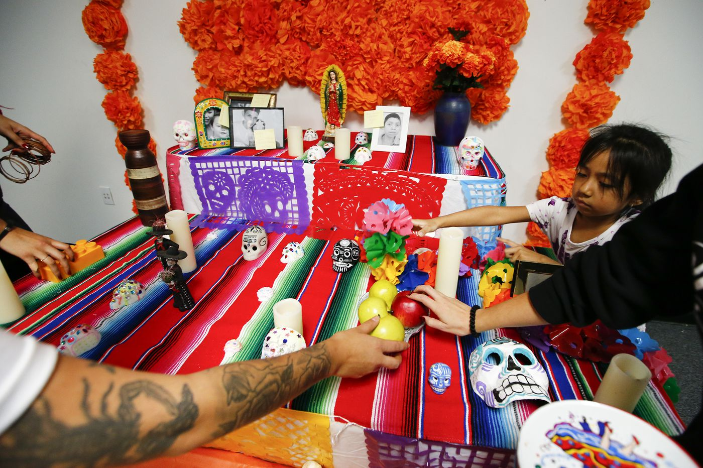 A Philadelphia Day of the Dead memorial honors migrant kids who died crossing the border
