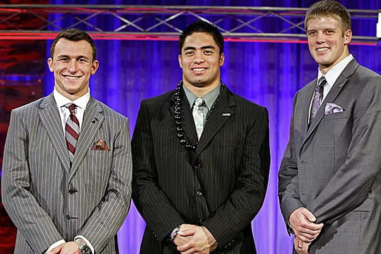 From left, Heisman Trophy candidates Texas A&M's Johnny Manziel, Notre Dame's Manti Te'o and Kansas State's Collin Klein pose for a photo. (John Raoux/AP)