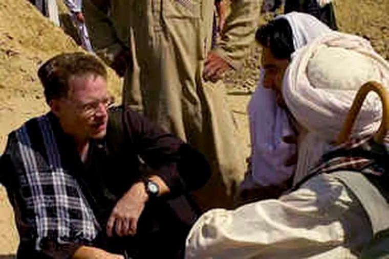 New York Times reporter David S. Rohde interviewing Afghans in a photograph by the Times' Tomas Munita believed to have been taken in 2007 in the Helmand region of Afghanistan.