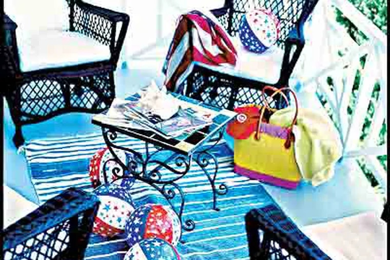 """The front porch of Emmerling's bungalow in Laguna Beach, Calif. The chairs are """"punctuation,"""" and beach balls add fun. (Carter Berg/ """"Mary Emmerling's Beach Cottages"""")"""