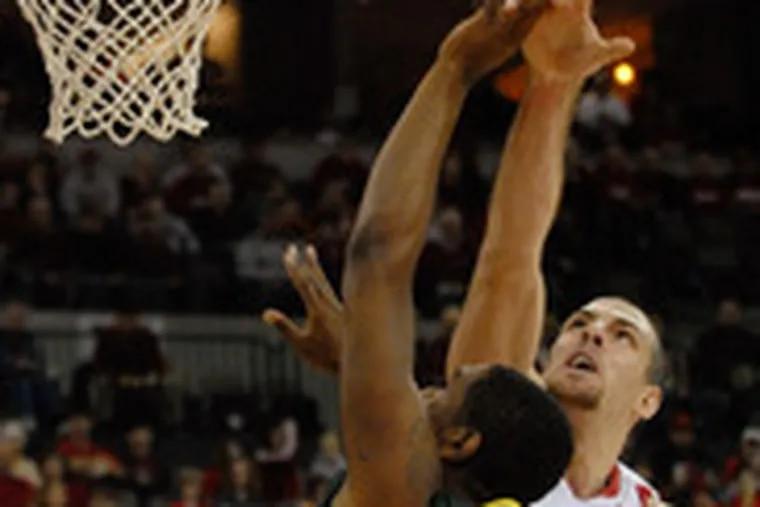 Nebraska's Aleks Maric blocks a shot by Oregon's Joevan Catron. Maric had three blocks to go with his 23 points.