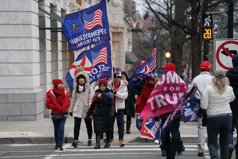 Supporters of President Donald Trump gather in Washington on Wednesday morning, hours before Congress convenes a joint session to finalize President-elect Joe Biden's victory.