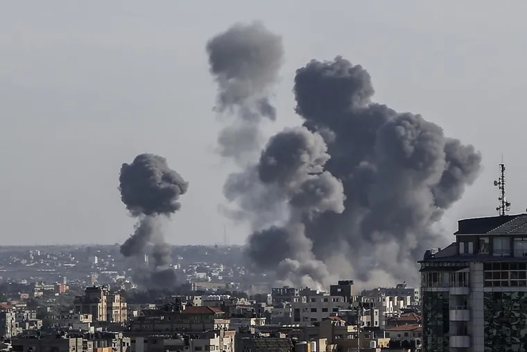 Smoke rises from buildings after Israeli air strikes in Gaza City on Saturday, May 4, 2019. Palestinian militants launched about 200 rockets and mortars into southern Israel from Gaza on Saturday, and the Israeli military responded with airstrikes and tank fire against targets across the Palestinian coastal territory.