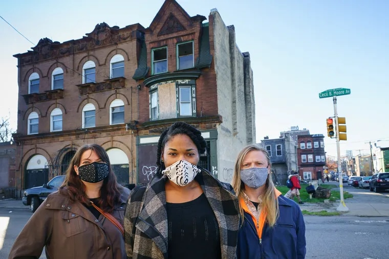 (Left to Right) Dana Rice, Maya Thomas, and Chris Mulford, preservationist activists, shown here in front of the Dox Thrash House, which is the building behind them on the right, Thursday, December 10, 2020, in Philadelphia.