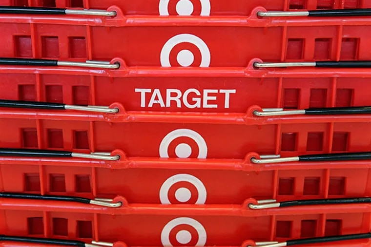 Shopping baskets are stacked at a Chicago area Target store. (AP Photo/Charles Rex Arbogast, File)