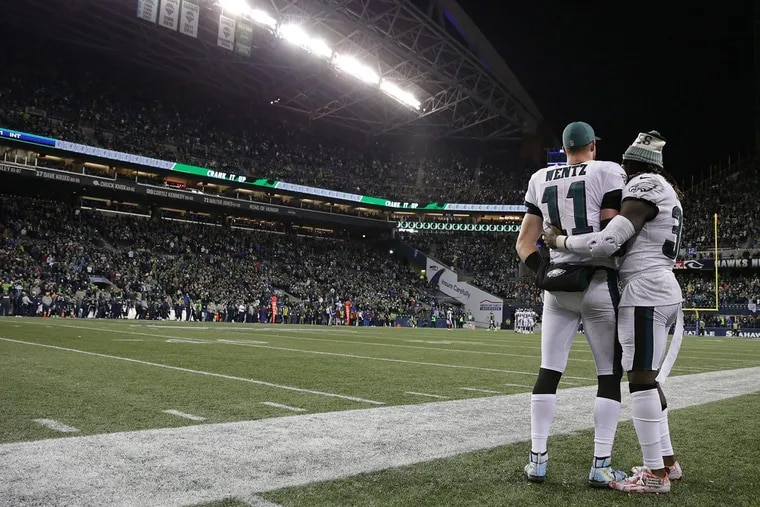 Eagles' Carson Wentz, gets a hug from Jay Ajayi late in the 4th quarter during Sunday's 24-10 loss to the Seattle Seahawks.