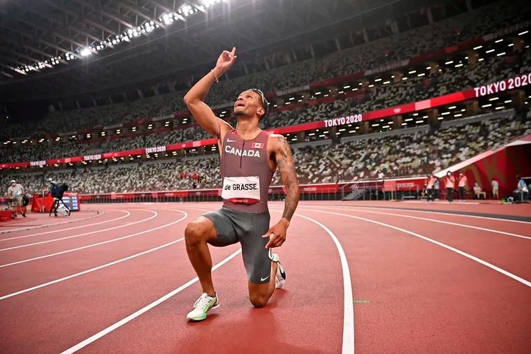 Andre De Grasse celebrates after winning gold in the men's 200m.