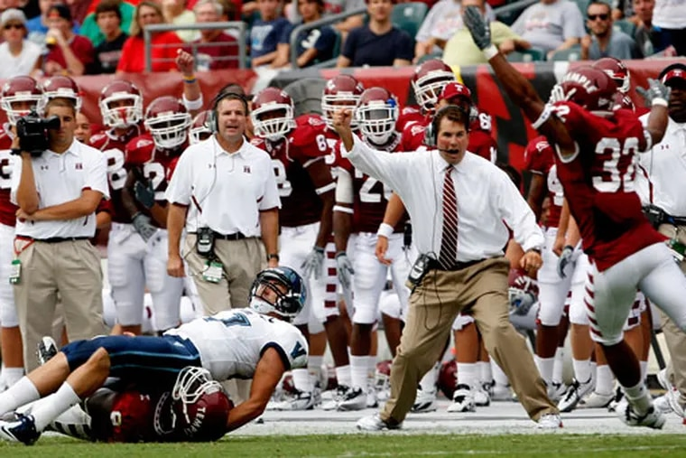 Former Temple head coach Al Golden reacts after a hit by Muhammad Wilkerson forces an interception against Villanova.