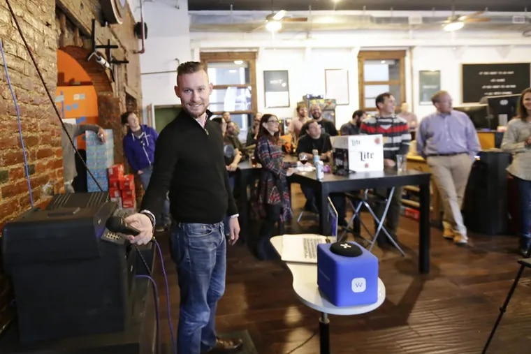 WebLinc CEO Darren Hill hands off the microphone after speaking briefly in WebLinc's offices above National Mechanics in Philadelphia on Nov. 17, 2017.