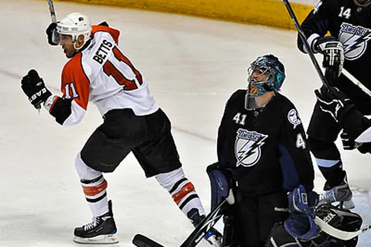 Blair Betts celebrated after scoring one of his two goals in the Flyers' win over the Lightning. (Steve Nesius/AP)