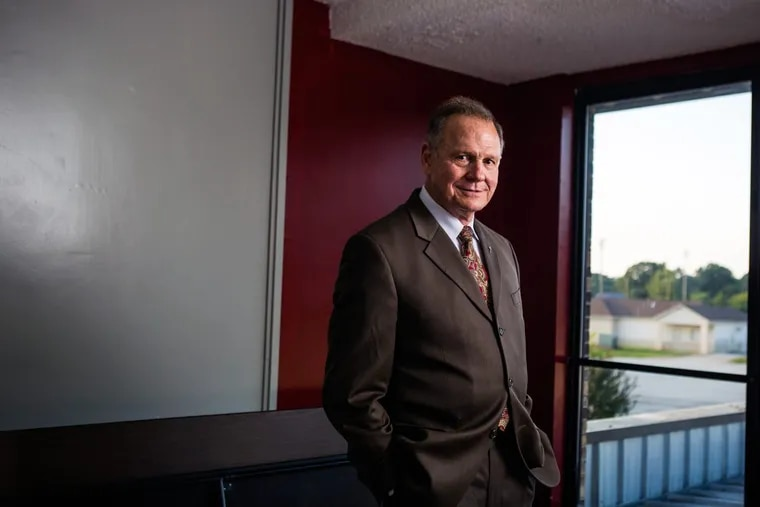 """Judge Roy Moore poses for a portrait after a """"Faith and Family Rally"""" in Florence, Ala."""