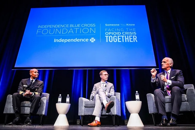 U.S. Surgeon General Jerome Adams, recovery advocate Luke Gorman and Independence Blue Cross CEO Dan Hilferty speak at a panel at an IBX opioid conference in Philadelphia Tuesday.
