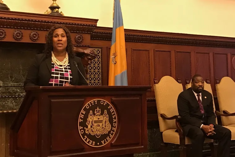 Keir Bradford-Grey speaks at a press conference about the elimination of Philadelphia's 30 percent fee on money bail, while City Councilman Kenyatta Johnson listens.