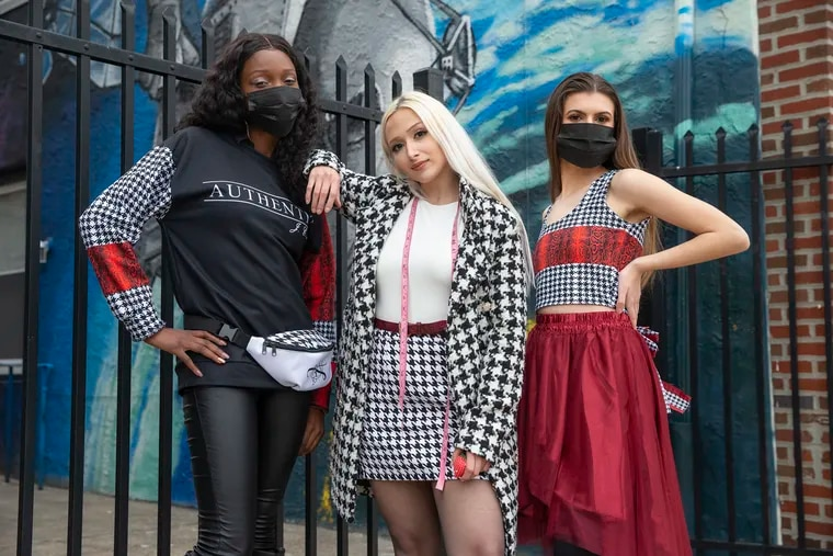 Jacqueline City (center) with two of her fashions, modeled by Alana Edwards (left) and Madison Hodges. Additional styling by Victoria Odom.