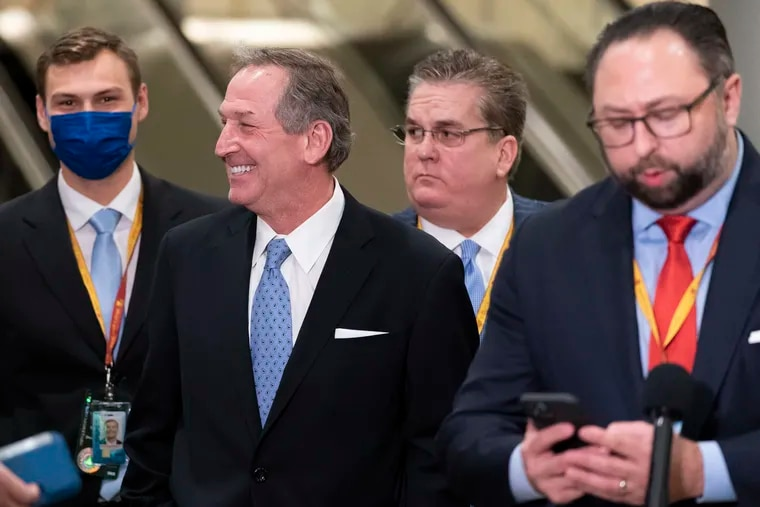 Michael van der Veen, second from left, an attorney for former President Donald Trump, after Trump was acquitted in his second impeachment trial, along with William J. Brennan, third from left, another Trump lawyer, and Trump spokesperson Jason Miller, right.