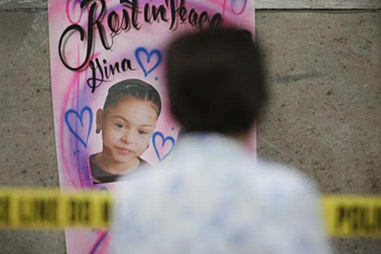 A poster of Gina Marie Rosario on the wall outside the Feltonville rowhouse where she died along with 3 others. The suspected driver of the car is partially paralyzed. (Alejandro Alvarez / Staff Photographer)