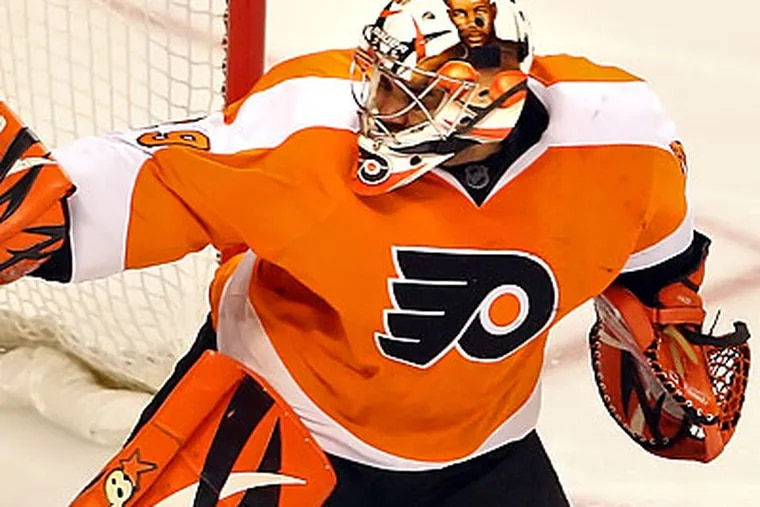 Flyers general manager Paul Holmgren said Emery has been injured for more than three weeks - and blamed his recent struggles on the problem. (Steven M. Falk/Staff file photo)
