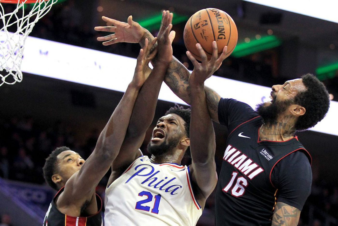 Sixers hold on to win 103-97 on a night they honored the Eagles