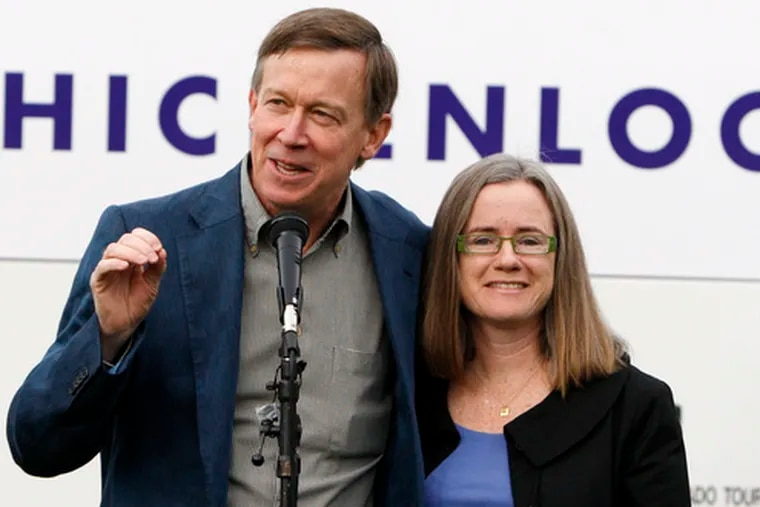 Colorado governor candidate John Hickenlooper, a Democrat, with wife Helen Thorpe, speaks at a rally in Denver, where he is mayor. It's an unpredictable election in an unpredictable state.