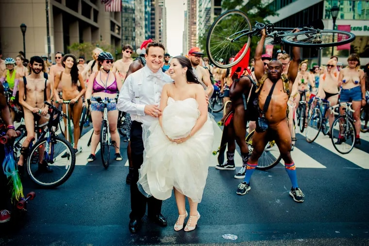 Ross and Blair Cohen snap photos with the Naked Bike Ride in 2015 on their wedding day.