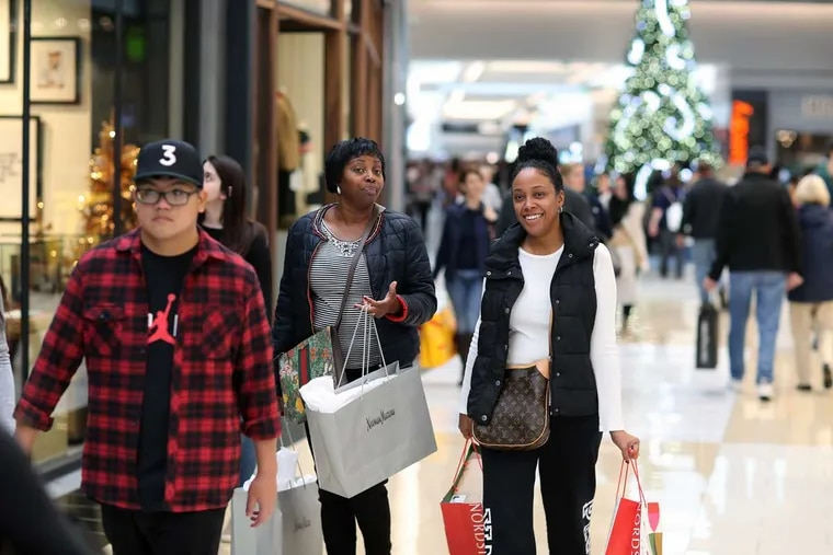 Karen Apollon, 48, of Fort Lee, N.J., and  Delores Robinson, 45, of Woolwich, N.J.,  shop at the King of Prussia Mall on Black Friday.