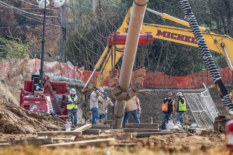 Pipe fitters connect a segment of pipe of the Mariner East 2 pipeline in West Chester at Ship Road and South Pullman Drive before it was pulled underground in a residential area in 2019.