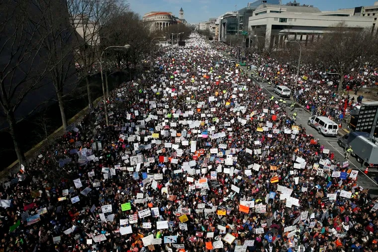 """Looking west toward the White House, people fill Pennsylvania Avenue in Washington during the """"March for Our Lives"""" rally in support of gun control on March 24, 2018. The rally was organized following the mass shooting that killed 17 people at Marjory Stoneman Douglas High School in Parkland, Fla., on Feb. 14."""
