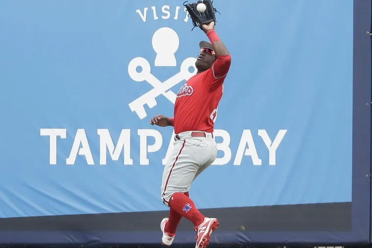 Phillies center fielder Odubel Herrera catches Tampa Bay Rays Jason Coats' fly ball in the fourth-inning during a spring training game at the Charlotte Sports Park in Port Charlotte, FL on Friday.