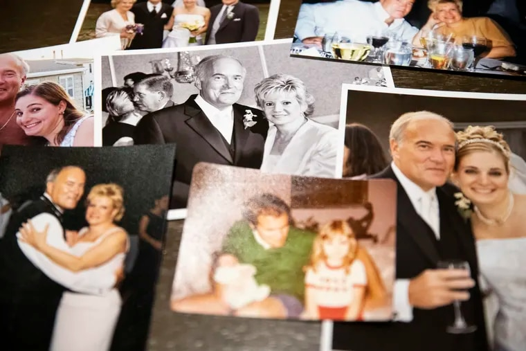 An assortment of Janelle Kilinski's Longshore family photos seen in Mount Laurel, New Jersey, Wednesday, November 13, 2019. In 2004 George Longshore was killed in Washington, DC outside of a friend's wedding reception, the case is still unsolved.