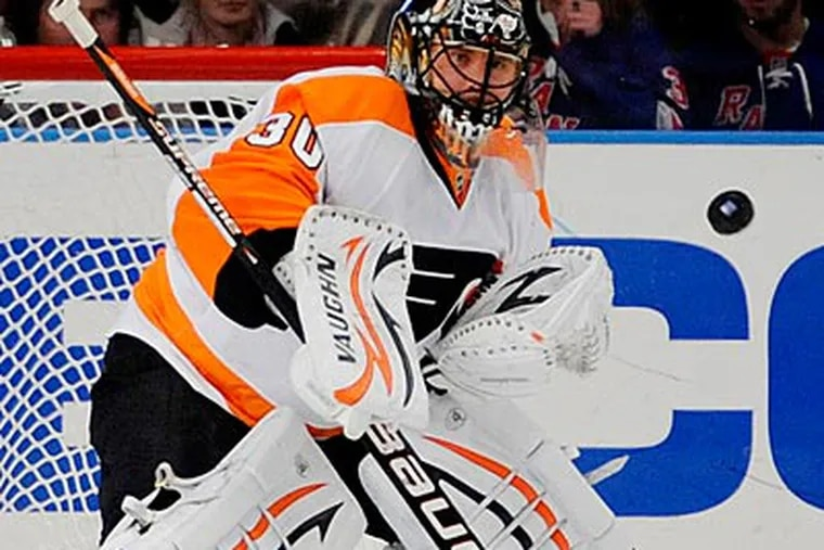 """""""Maybe we should play tighter defense and box out the guys,"""" Ilya Bryzgalov said. (Henny Ray Abrams/AP)"""