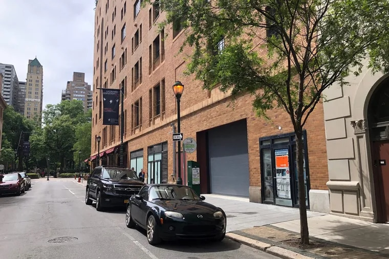 Orange sign denotes a future restaurant on the 1700 block of Locust Street owned by Michael Schulson. Parc is to the left, with Rittenhouse Square in background.