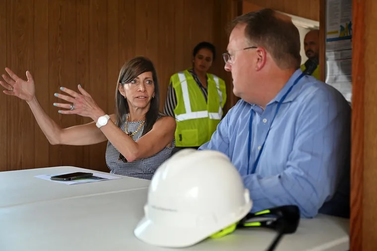 Tammy Murphy (left) talks with Lee Laurendeau (right), CEO of EEW American Offshore Structures, before a tour of his site in July at the Paulsboro Marine Terminal.