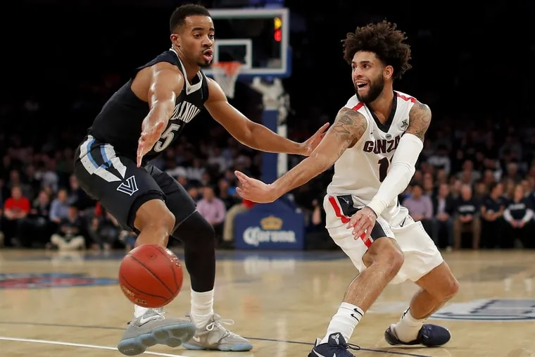 Phil Booth, one of the former redshirts for Villanova, defends Gonzaga guard Josh Perkins (13) during the first half Tuesday.