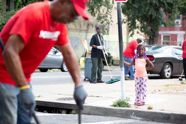 Who are those men in T-shirts and hats, cleaning North Philly to repair their worlds? | Helen Ubiñas